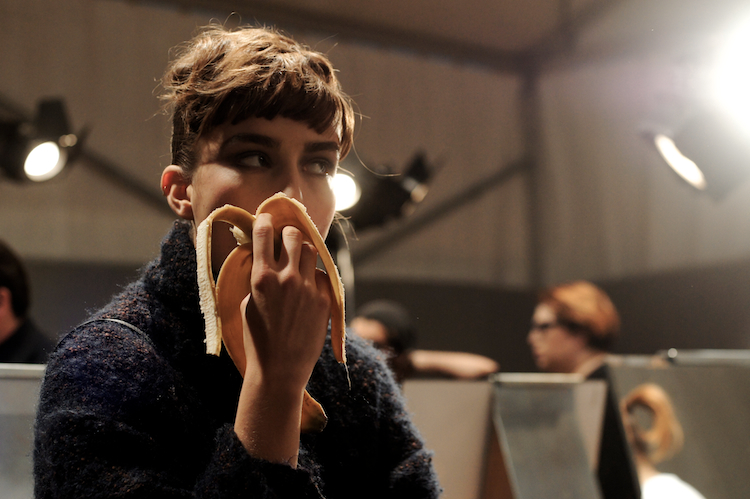 model eating a banana